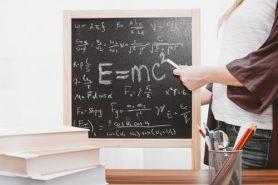 blackboard with white writing and E=mc squared