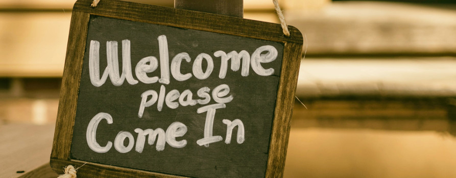 Blackboard saying welcome please come in